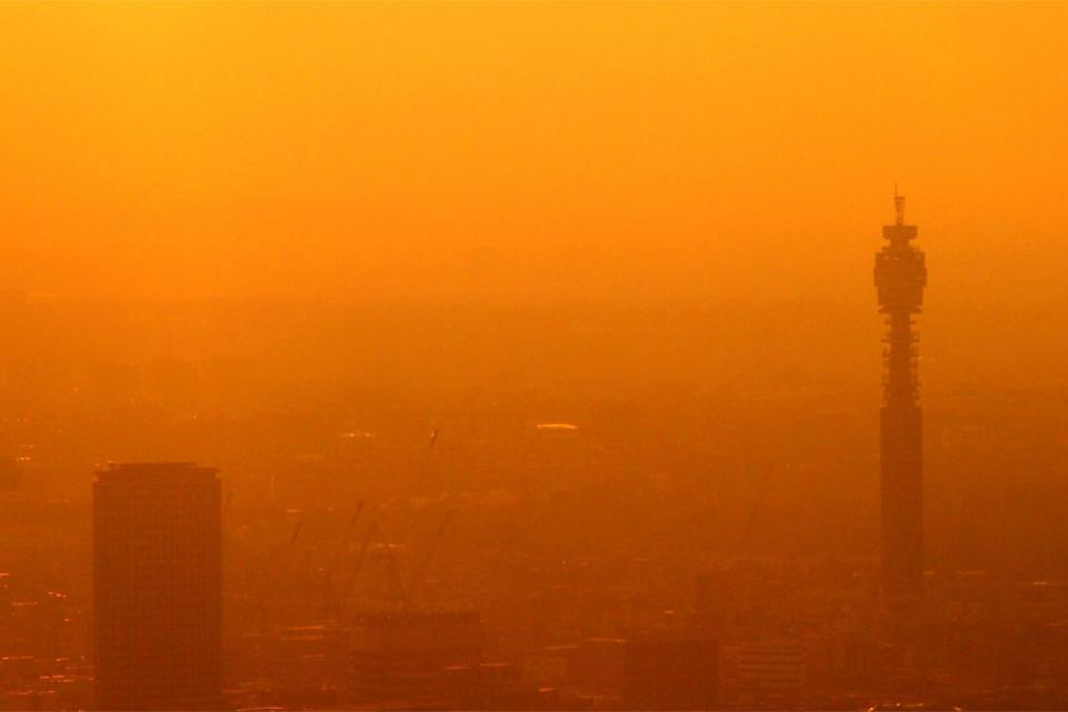 photo of sunset in smoggy city