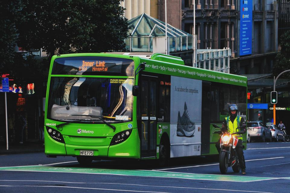 Green bus at traffic lights
