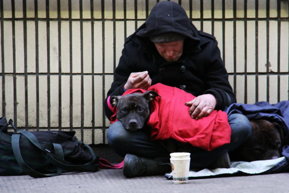 Male rough sleeper with his dog